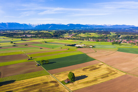 Germany, Bavaria, Huglfing, Drone view of countryside fields in Alpine foothills during spring