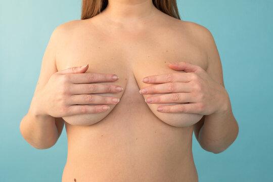 Crop plump model covering breast