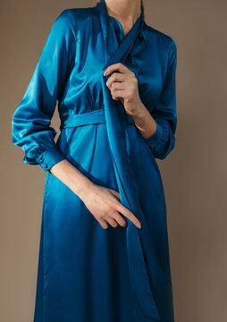 Crop female in blue dress