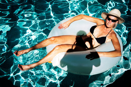 A woman floats in a cool pool.