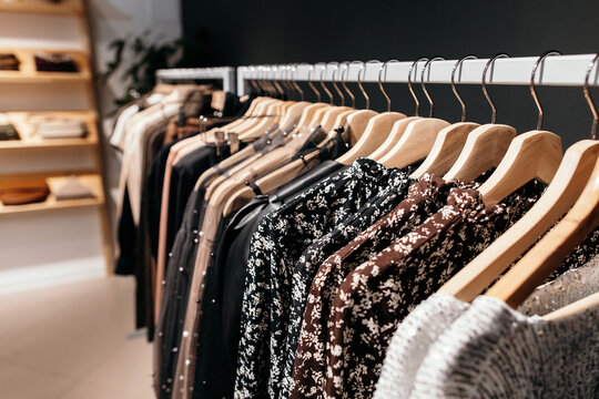 Rack with trendy clothes in store