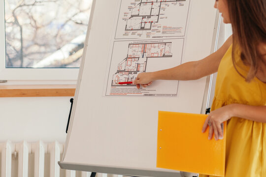 Anonymous architect showing blueprints during conference