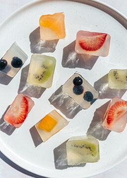 Japanese fruit jellies with fresh fruit on ceramic plate