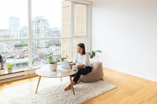 Female working from home in minimalist apartment