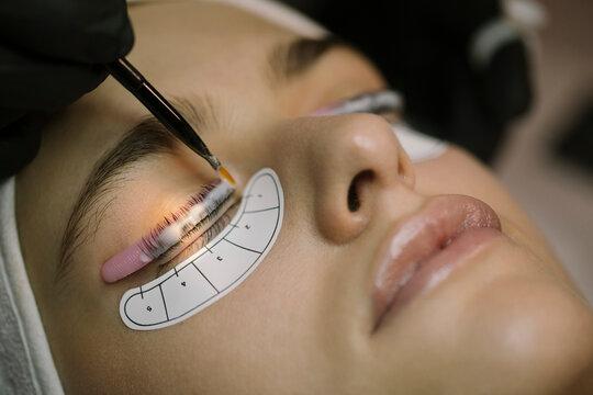 Young Woman Getting Natural Eyelash Treatment