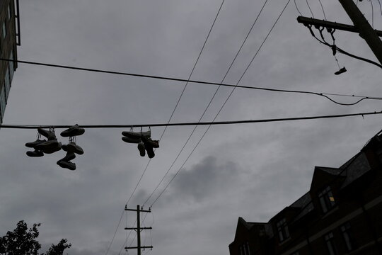Shoes hang from telephone wires on the University of Michigan campus in Ann Arbor