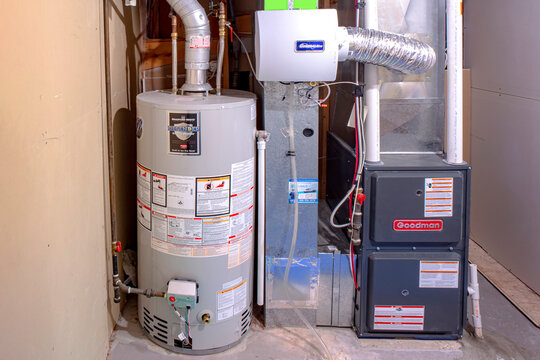 Calgary, Alberta, Canada. Sep 21, 2020. A home Goodman high efficiency furnace with Bradford White Residential gas water heater & an Generalaire humidifier.