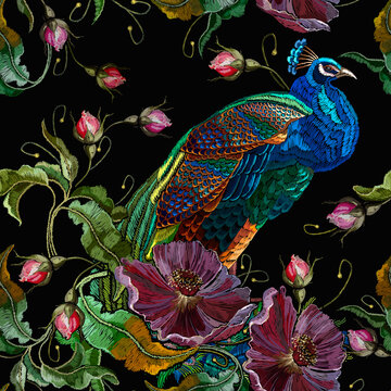 Embroidery peacocks and violet flowers seamless pattern. Fashionable template for design of clothes