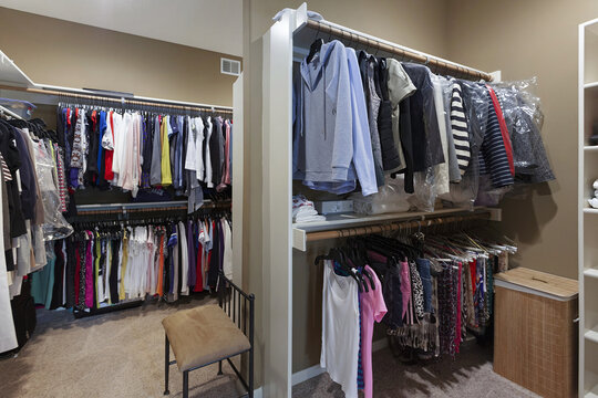 Master closet with clothes hanging