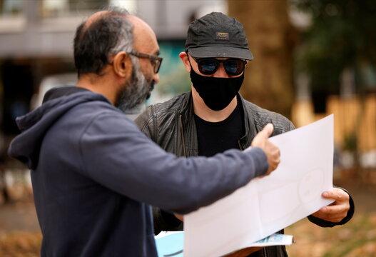 British street artist STIK signs copy of free print in London