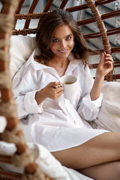 Morning coffee in white shirt