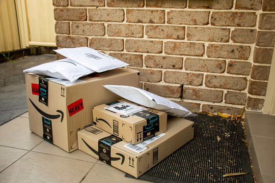Sydney, Australia - 2020-10-17 Amazon prime boxes and envelopes delivered to a front door of residential building