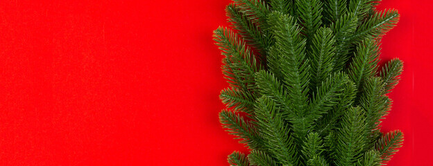 Wall Mural - Top view of colorful background made of green fir tree branches. New year holiday Banner concept with copy space