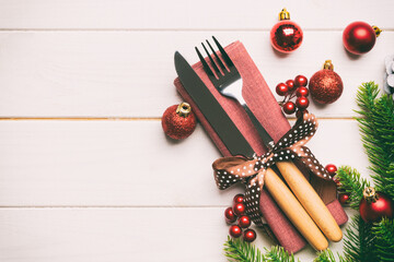 Wall Mural - Top view of festive cutlery on new year wooden background. Christmas decorations with empty space for your design. Holiday dinner concept