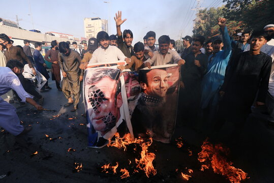 People protest against cartoon publications of Prophet Mohammad in France and Macron's comments, in Peshawar