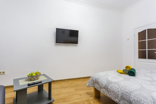 Interior of the modern luxure bedroom in studio apartments in light color style
