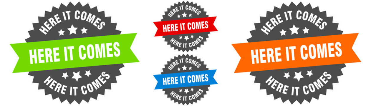 here it comes sign. round ribbon label set. Seal
