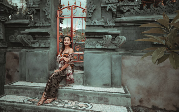 Local Balinese girl in their beautiful traditional clothing at Hindu temple.