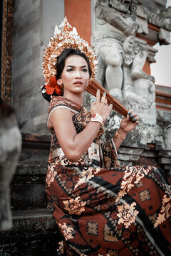 Local Balinese girl in their beautiful traditional clothing at temple.