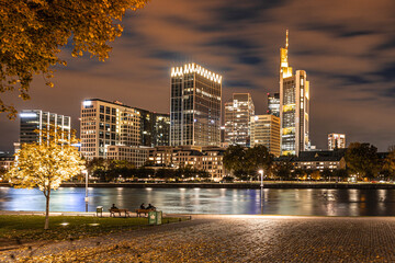 city skyline at night, people walk on the main river Wall mural