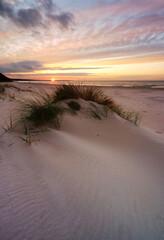 Morze Bałtyckie ,zachód słońca,wydma,trawa,plaża,biały piasek,Kołobrzeg,Polska.
