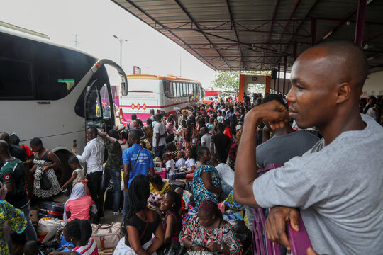 Residents wait at the bus station as they prepare to leave the capital for the remote villages ahead of a contentious election many fear could turn violent, in Abidjan
