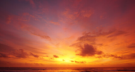 Nature background. Shot of Landscape amazing of red sky sunset in the sea with red clouds background. Travel concept.