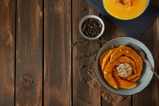baked pumpkin with oil and spices