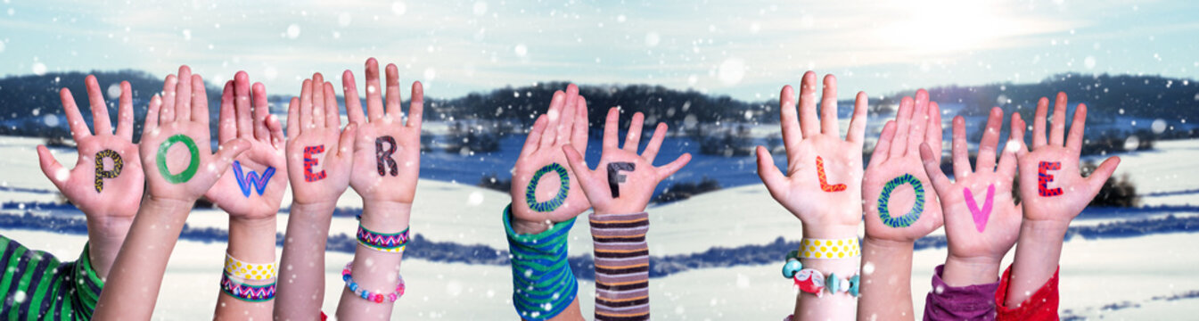 Children Hands Building Colorful English Word Power Of Love. Snowy Winter Background With Snowflakes