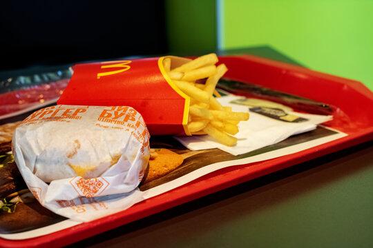 BELARUS, VITEBSK - OCTOBER 21, 2019: French fries and cheeseburger at mcdonalds