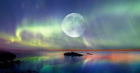 "Northern lights (Aurora borealis) in the sky with super full moon - Tromso, Norway ""Elements of this image furnished by NASA"""