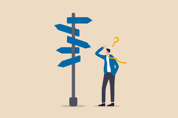 Fototapeta Business decision making, career path, work direction or leadership to choose the right way to success concept, confusing businessman manager looking at multiple road sign and thinking which way to go obraz