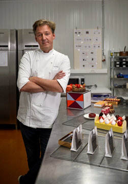 Belgian chocolatier Pierre Marcolini poses for a picture after being crowned best pastry chef in the world by his peers at international competition, in Brussels