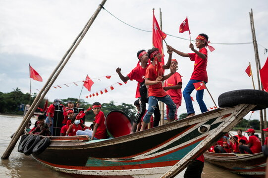 Supporters of the National League for Democracy party take part in a boat rally ahead of a November 8 general election, amid the coronavirus disease spread in the Yangon river, Myanmar,