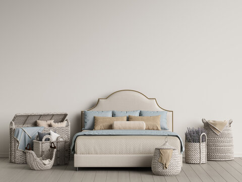 Classic bed and wicker baskets in light interior