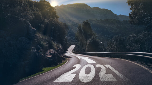 year 2021 and arrow on long winding road, moving on to new year concept