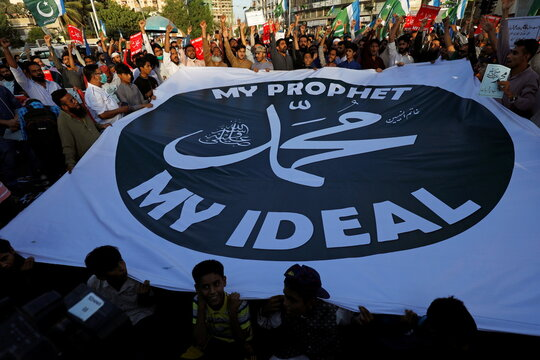 People protest against cartoon publications of Prophet Mohammad in France and Macron's comments, in Karachi
