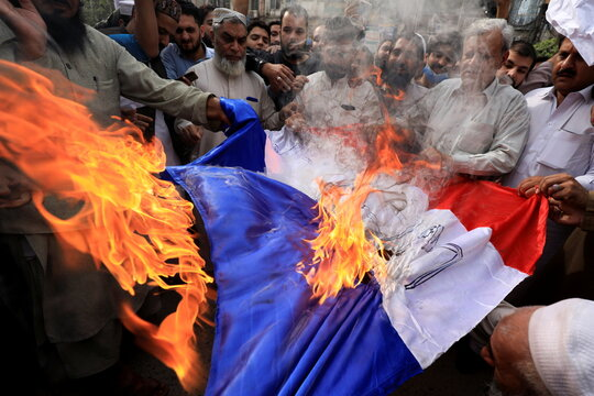 People protest against the cartoon publications of Prophet Mohammad in France and comments by the French President Emmanuel Macron, in Peshawar