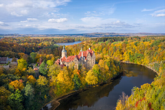 Aerial view of Czocha Castle surrounded by autumn forest and Lesnianskie Lake
