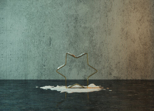 3d rendering of golden star shape covered by snow in front of grunge wall background with reflection floor