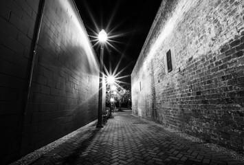 Street lamps in an alley Fotomurales