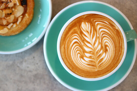 cup of hot latte art coffee
