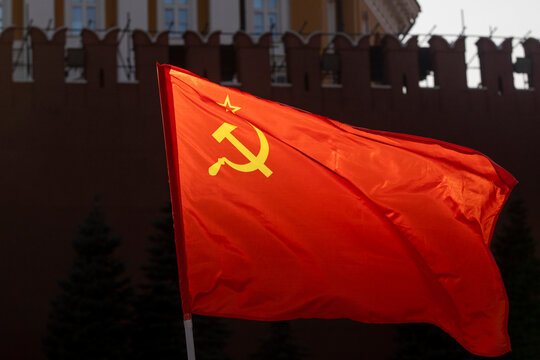The flag of the USSR on the background of the Kremlin wall on the Red Square in Moscow