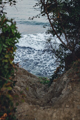 descent to the sea, cliff, waves on the beach
