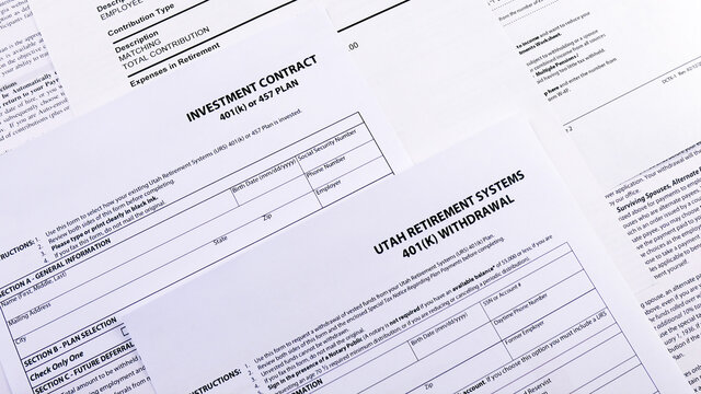 Conceptual composition. Pension savings. Blank form Investment contract 401 k or 457 plan, blank form Utah retirement system 401 k , Personal 401k plan and GSEPS 401k plan Opt-Out form. Close-up