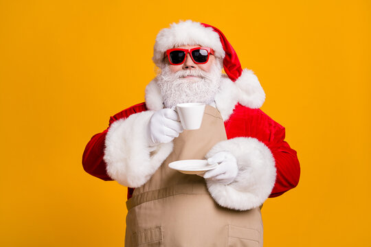 Portrait of his he nice attractive confident Santa businessman entrepreneur drinking aromatic robusta natural latte beverage rest isolated over bright vivid shine vibrant yellow color background