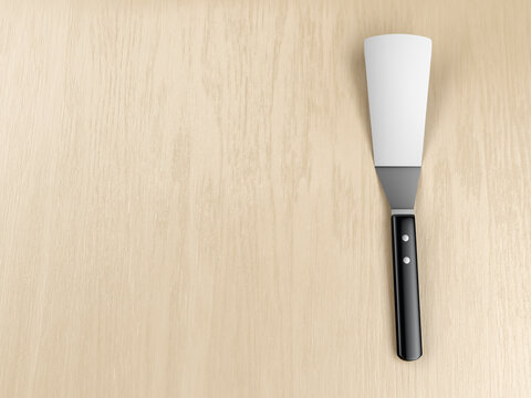 Kitchen spatula on wooden table, top view