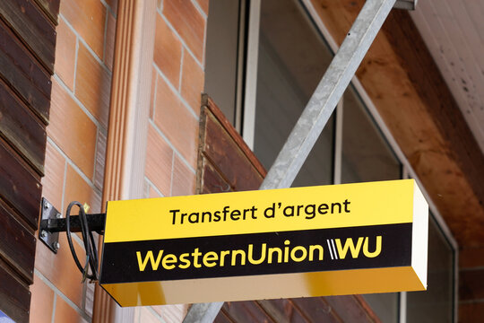 Western Union sign text and logo on facade company american financial services