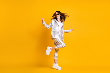 Full length body size side profile photo of girl wearing checkered suit round sunglass dancing laughing isolated on bright color background