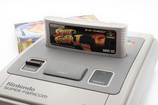 Fukuoka, Japan - may 1, 2019 : the famous Capcom 1990's hit street fighter 2 cartridge plug in the original Nintendo Super Famicom